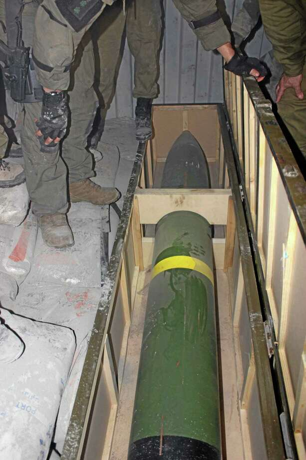This photo released by the Israel Defense Forces shows a missile on an intercepted ship in the Red Sea Wednesday, March 5, 2014. Israeli naval forces raided a ship deep in the Red Sea early Wednesday and seized dozens of advanced rockets from Iran destined for Palestinian militants in Gaza, the military said. (AP Photo/IDF) Photo: AP / IDF