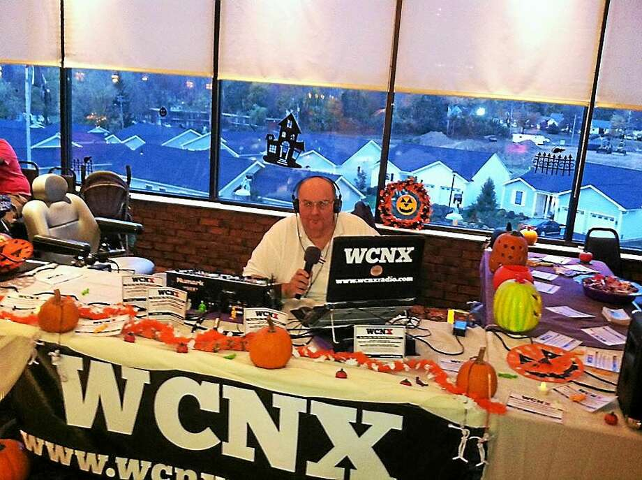WCNX-AM online radio, based in Middletown and shown here in a 2013 photo from the Middletown Elks Halloween party, is recording greetings to U.S. troops serving overseas in Cromwell this week and next. Photo: Courtesy WCNX Radio