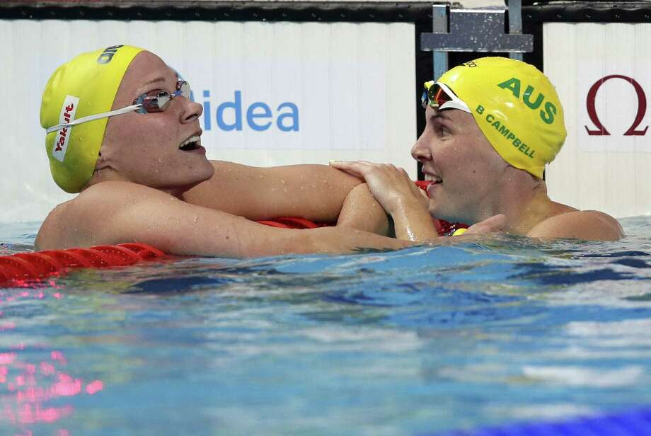 Australia's Bronte Campbell, right, is congratulated by her sister, Cate, after winning the 100 freestyle final at the Swimming World Championships on Friday in Kazan, Russia. Cate Campbell won the bronze medal. Photo: Michael Sohn — The Associated Press  / AP