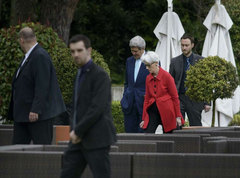 U.S. Secretary of State John Kerry, center and US Under Secretary for Political Affairs Wendy Sherman, centre right, as they walk in a courtyard, at the Beau Rivage Palace Hotel, during an extended round of talks on Iran's nuclear program on April 2, 2015, in Lausanne, Switzerland. Photo: AP Photo/Brendan Smialowski, Pool  / POOL AFP