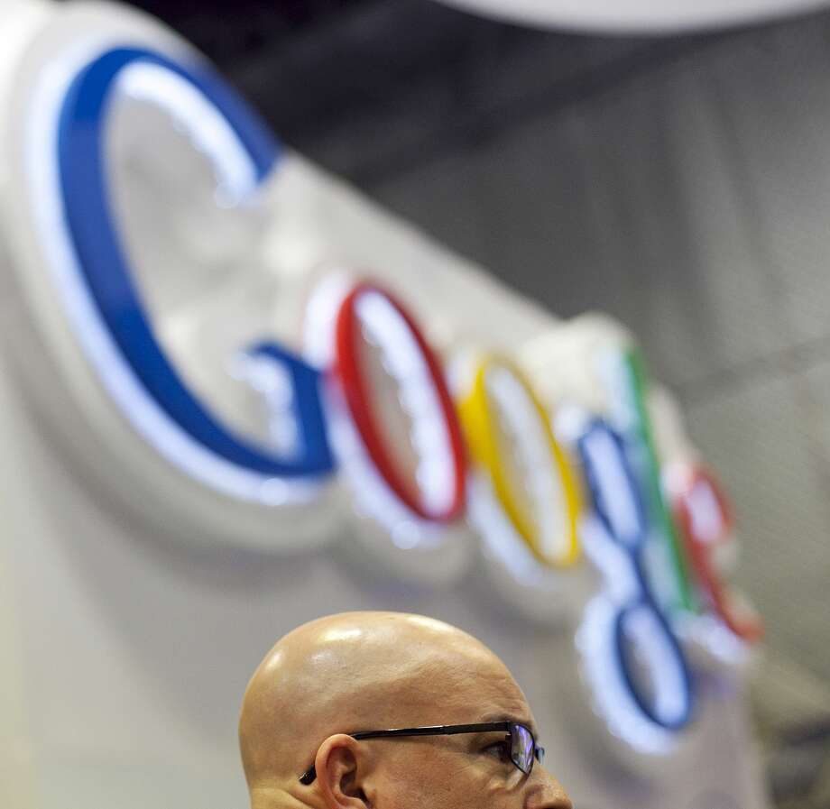 In a Tuesday, Jan. 17, 2012 file photo, an attendee at the National Retail Federation listens to a discussion about Google Wallet in New York. Photo: AP File Photo  / AP2012