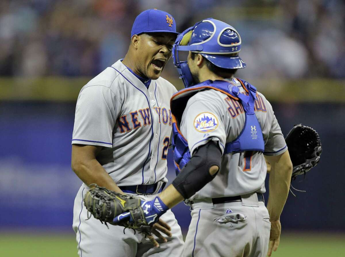 Mets relief pitcher Jeurys Familia, left, celebrates with catcher Travis d'Arnaud after closing out the Tampa Bay Rays in the ninth inning on Friday.
