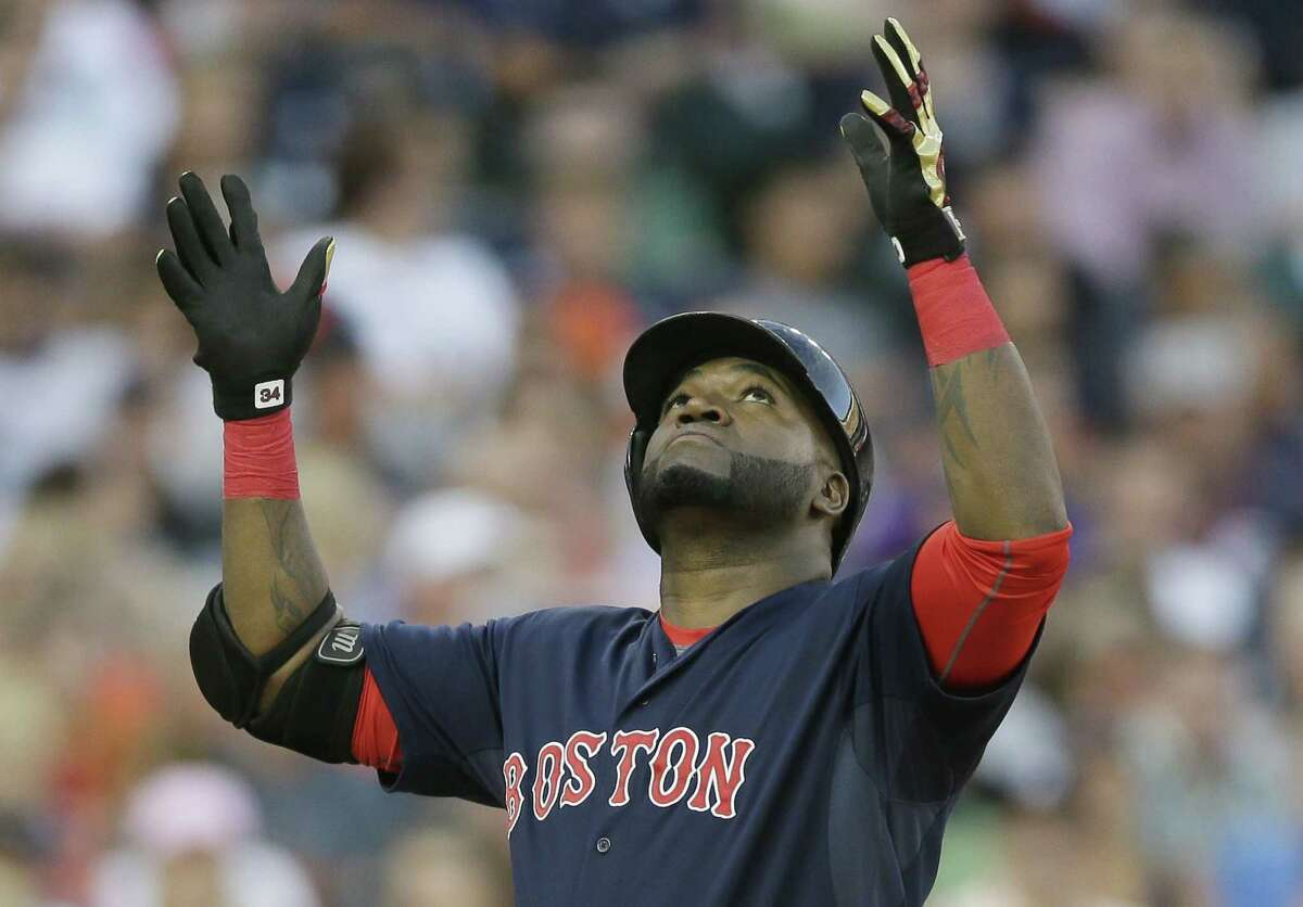 Red Sox designated hitter David Ortiz looks skyward after reaching home plate on his two-run home run on Friday.