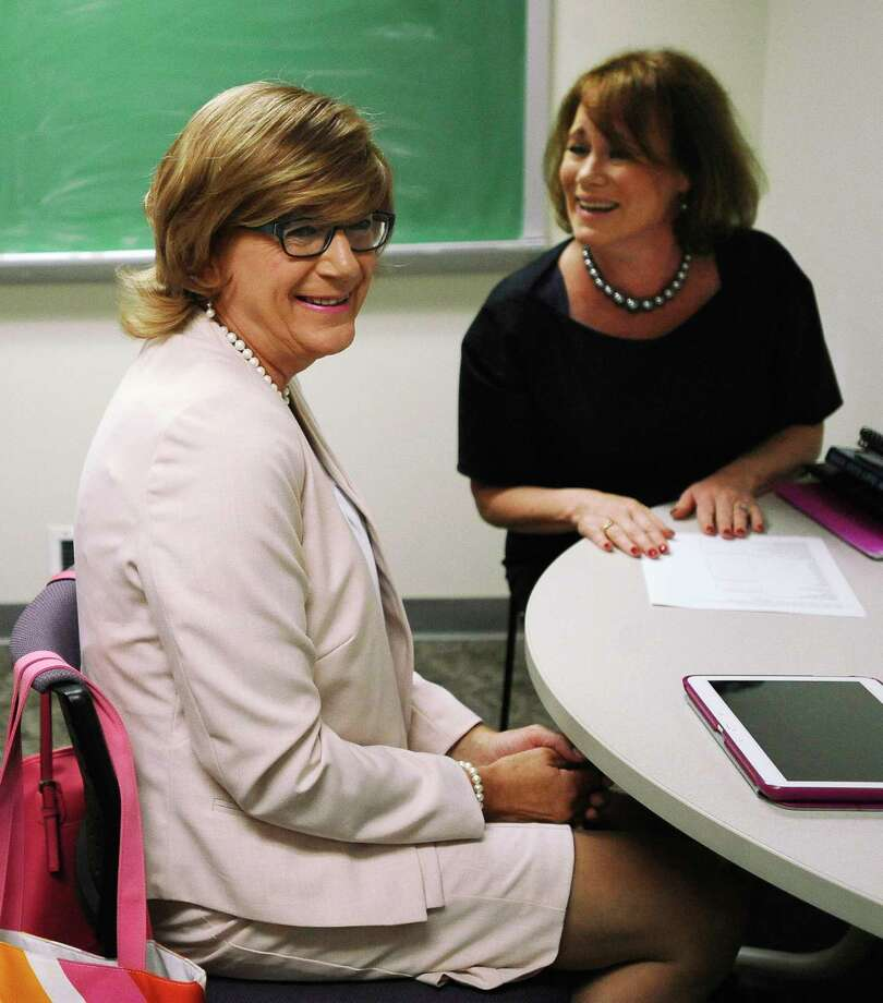 In this July 22, 2015, photo, Brianne Roberts, left, smiles as she works on voice exercises with speech-language pathologist Jean McCarthy, right, at the University of Connecticut's Speech and Hearing Clinic in Storrs, Conn. Roberts is in a program at UConn that teaches transgender people how to sound more like the sex with which they identify. Photo: AP Photo/Jessica Hill / FR125654 AP