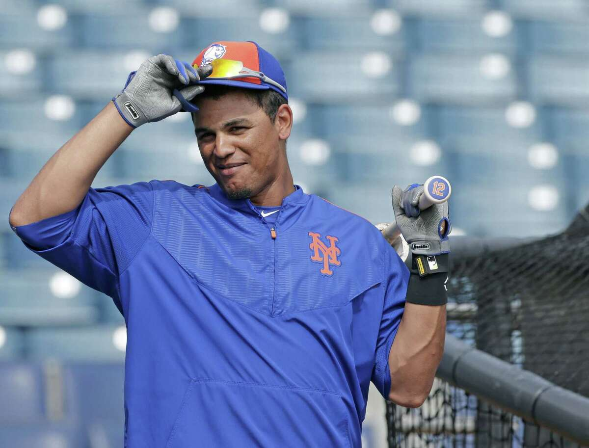 New York Mets center fielder Juan Lagares waits his turn in the batting cage before a spring training game against the New York Yankees last week in Tampa, Fla.