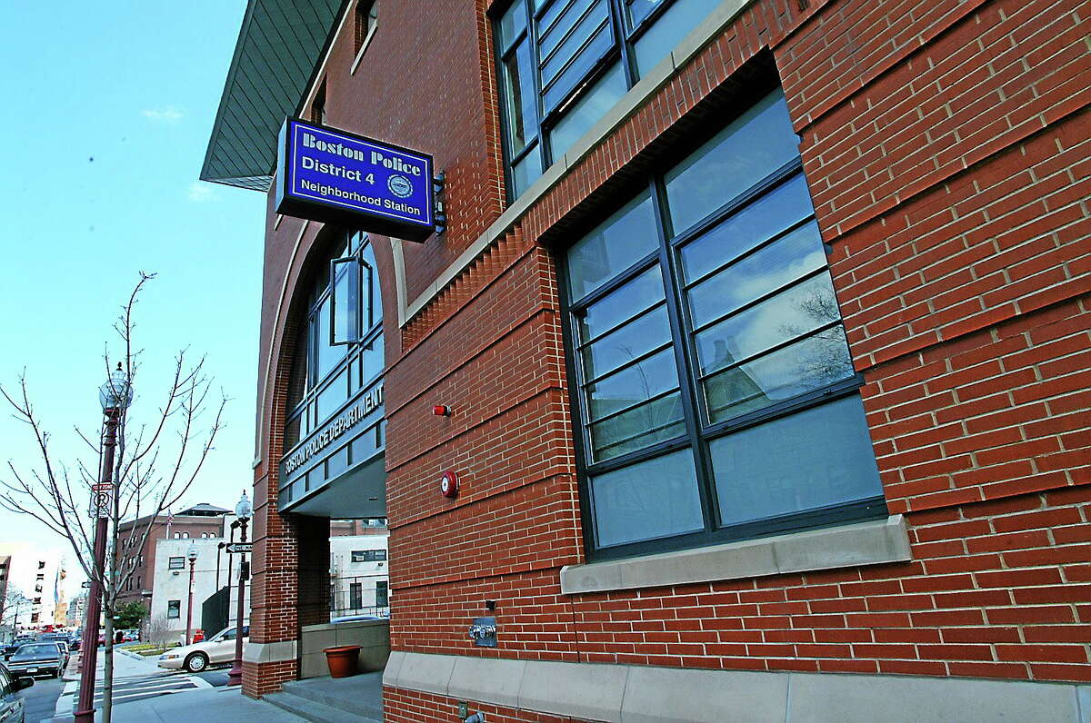 The outside of the Boston Police Department's District 4 station. Police said a Stratford, Connecticut man was arrested after he was found sleeping in a marked police cruiser outside the station, not long after he was released on bail on a car theft charge.