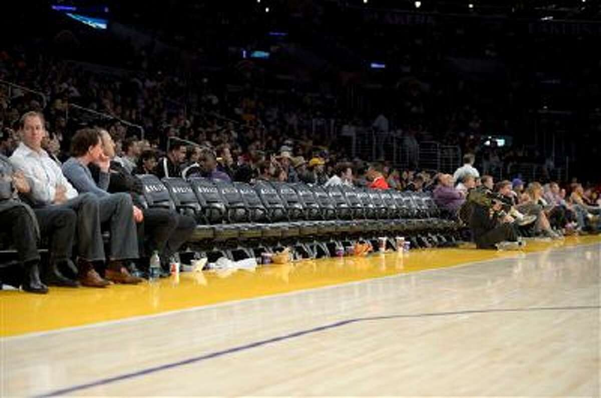 Several empty seats are seen with two minutes left in the Los Angeles Lakers' NBA basketball game against the Detroit Pistons, Sunday, Nov. 4, 2012, in Los Angeles. The Lakers won 108-79. (AP Photo/Mark J. Terrill)