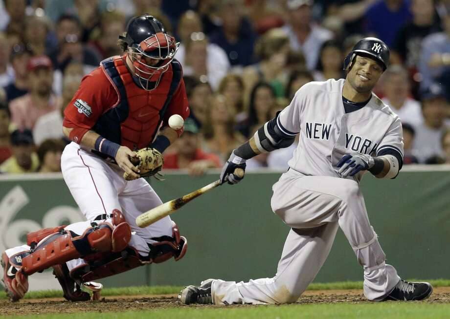 Boston Red Sox catcher Jarrod Saltalamacchia keeps the ball in front as New York Yankees' Robinson Cano swings for a strike in the fifth inning of a baseball game at Fenway Park in Boston on July 6, 2012. Photo: Elise Amendola — Associated Press  / AP