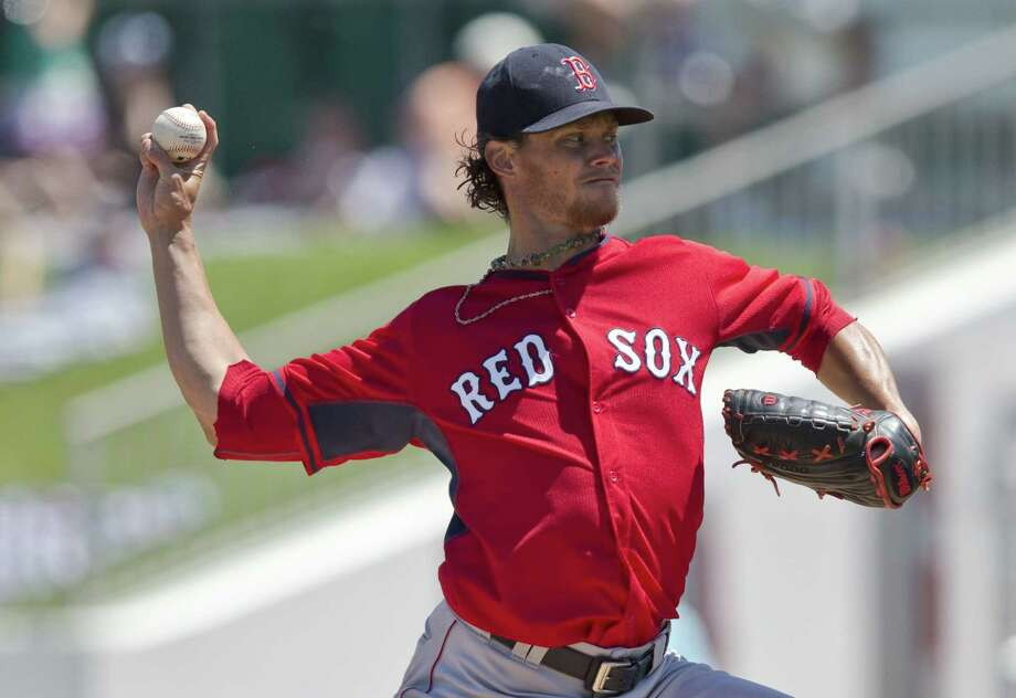 Boston Red Sox starter Clay Buchholz delivers against the Minnesota Twins Wednesday in Fort Myers, Fla. Photo: Brynn Anderson — The Associated Press  / AP