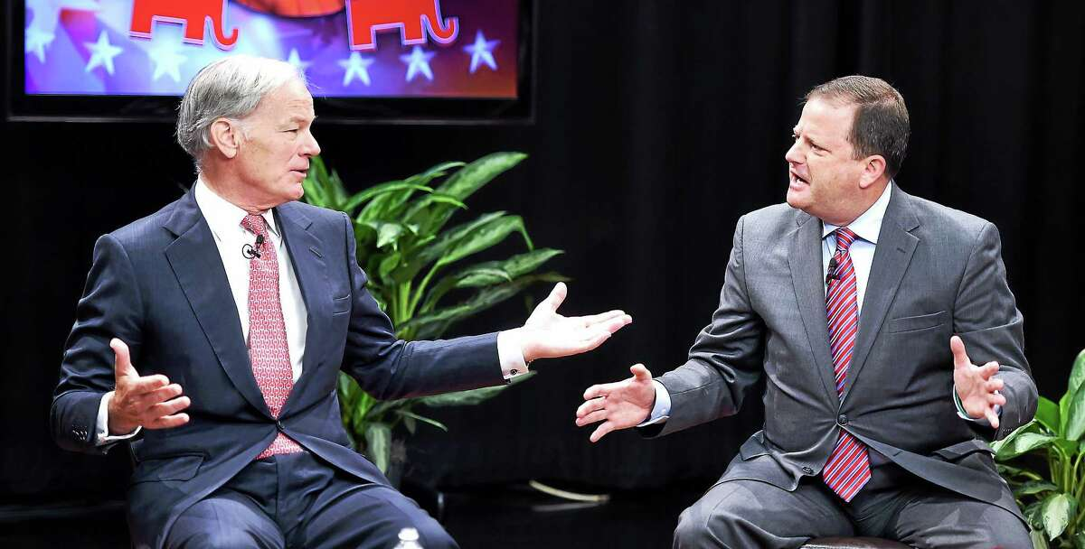 Republican gubernatorial candidates Tom Foley, left, and John McKinney spar at the Republican Primary Forum at WTNH-TV Sunday.