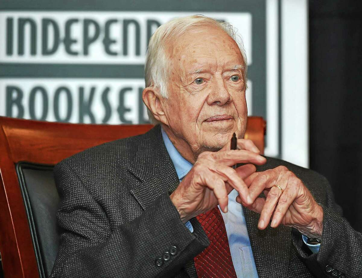 "Jimmy Carter, 39th president of the United States, pauses at a signing of his book, ""A Call to Action: Women, Religion, Violence and Power,"" at the New Haven Lawn Club Tuesday in New Haven."