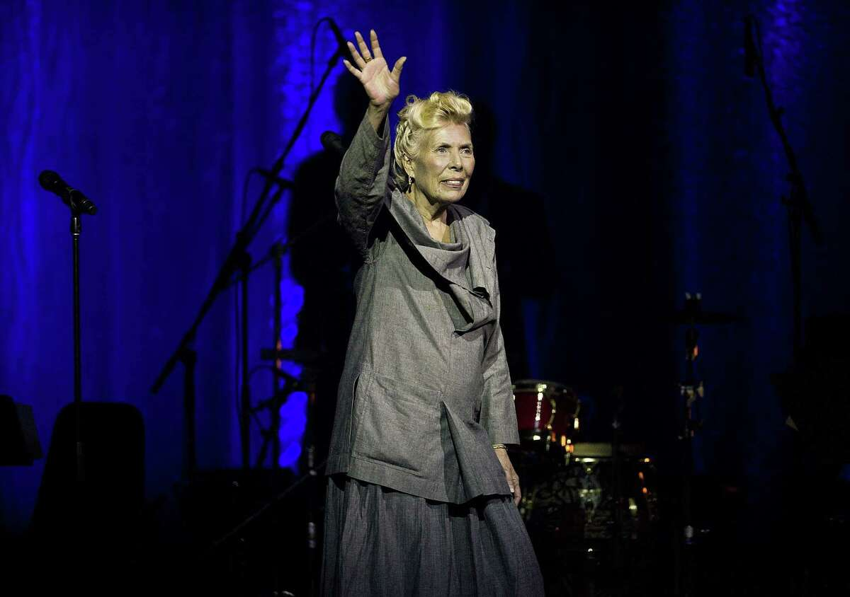 Joni Mitchell waves to the crowd during her 70th birthday tribute concert as part of the Luminato Festival at Massey Hall in Toronto on Tuesday June 18, 2013. Mitchell's website and Twitter account reported Tuesday night March 31, 2015 that she was in the hospital, but gave no details on her condition.