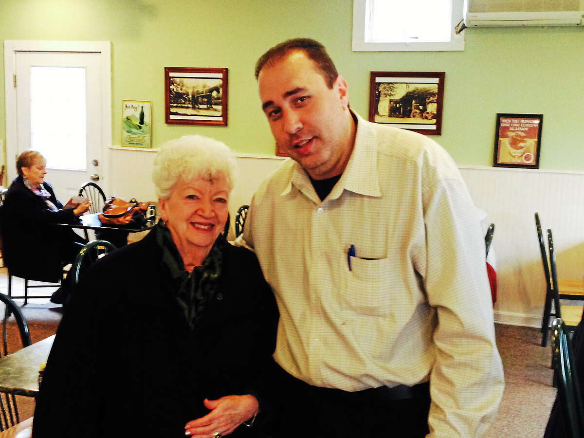 Dine In Durham owner Sam Zureiqi greets one of his favorite customers, Middletown resident Barbara Daigle, who stopped by Wednesday for a quick lunch at the town's new restaurant located at 325 Main St. along Route 17.