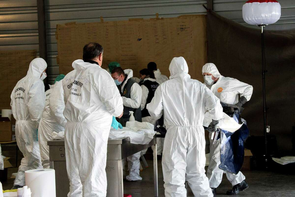 This photo provided Monday March 30 2015 by the French Gendarmerie Nationale shows forensic experts of the French gendarmerie disaster victim identification unit (UGIVC) working near the site of the plane crash, in Seyne-les-Alpes, France, Thursday March 26, 2015. All 150 people on board were killed when the Germanwings Airbus A320 plane flying from Barcelona, Spain, to Duesseldorf, Germany, slammed into a French mountain on March 24 near the Alpine village of Le Vernet. (AP Photo/Fabrice Balsamo, Gendarmerie Nationale)