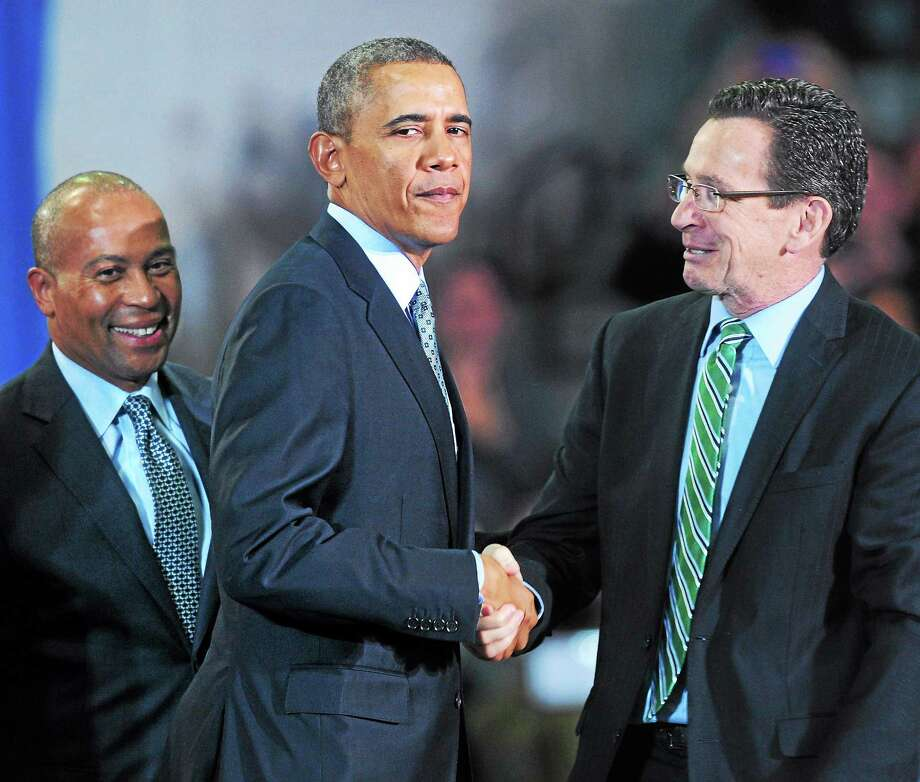 President Barack Obama shakes hands with Gov. Dannel P. Malloy after delivering a speech about raising the minimum wage at Central Connecticut State University in New Britain Wednesday. At left is Massachusetts Gov. Deval Patrick. Photo: Arnold Gold — New Haven Register