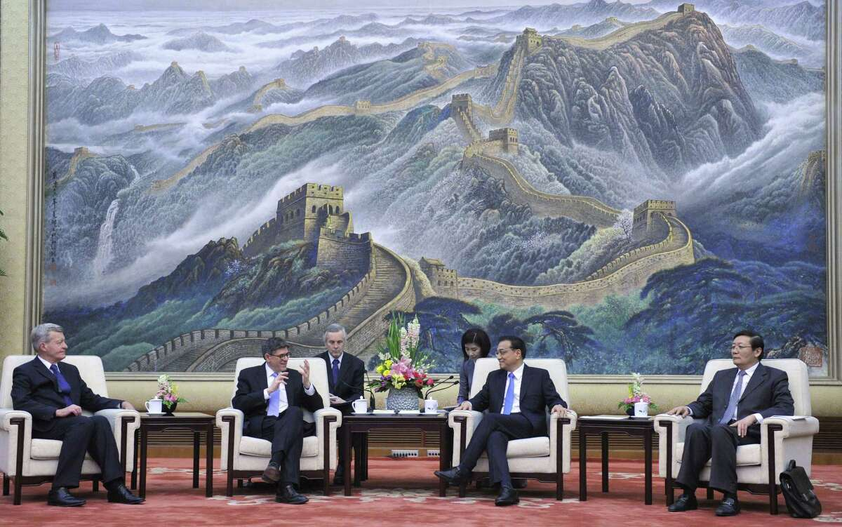 U.S. Ambassador to China Max Baucus, from left, U.S. Treasury Secretary Jacob Lew, Chinese Premier Li Keqiang, and Chinese Finance Minister Lou Jiwei attend a meeting at the Great Hall of the People in Beijing, China, on Monday, March 30, 2015. Lew said he pressed Chinese leaders Monday over proposed curbs on the use of foreign security products by banks and other restrictions on access to China's technology market. (AP Photo/Parker Song, Pool)