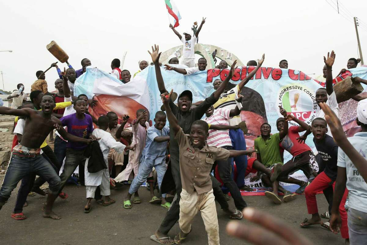 Residents celebrate the anticipated victory of Presidential candidate Muhammadu Buhari in Kaduna, Nigeria Tuesday, March 31, 2015. The spokesman for retired Gen. Muhammadu Buhari says the former military dictator has won Nigeriaís bitterly contested presidential election but fears ìtricksî from the government. Garba Shehu told The Associated Press that their polling agents across the country tell them they have succeeded in defeating President Goodluck Jonathan.(AP Photo/Jerome Delay)