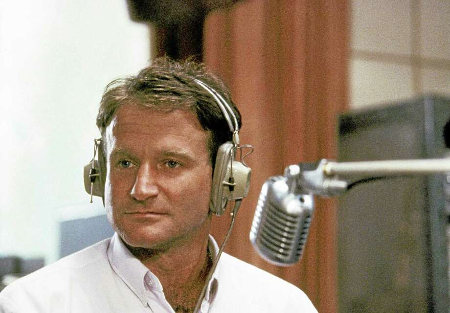 "FILE - This 1987 file photo released by Touchstone Pictures shows actor Robin Williams in character as disc-jockey Adrian Cronauer in director Barry Levinsons comedy drama, ""Good Morning Vietnam."" Williams, whose free-form comedy and adept impressions dazzled audiences for decades, has died in an apparent suicide. He was 63. The Marin County Sheriffís Office said Williams was pronounced dead at his home in California on Monday, Aug. 11, 2014. The sheriffís office said a preliminary investigation showed the cause of death to be a suicide due to asphyxia. (AP Photo/Touchstone Pictures) Photo: AP / Touchstone Pictures"