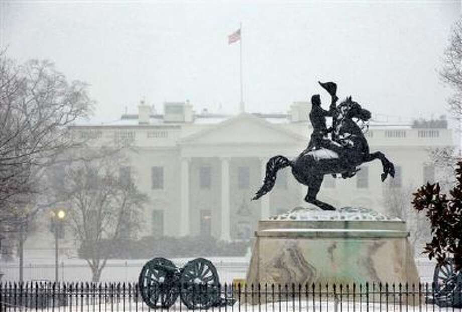 The statue of President Andrew Jackson at the Battle of New Orleans, sculpted in 1853 by Clark Mill sits in the falling snow in Lafayette Park across the street from the White House in Washington, Monday, March 3, 2014. The winter weather prompted area schools and the federal government to close and the National Weather Service has issued a Winter Storm Warning for the greater Washington Metropolitan region. (AP Photo/Pablo Martinez Monsivais) Photo: AP / AP