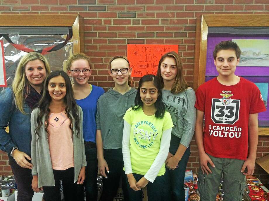 Cromwell Middle School students organized a food drive to benefit the town's food bank and with Christmas not far off, they're organizing a toy drive. Shown are Student Council faculty adviser Jamie Ritone, students Izabella Marselli, Marina Fletcher, Caroline Connelly, Anusha Khan, Kaedryn Pulling and Connor Barrows. Photo: Courtesy Jamie Ritone