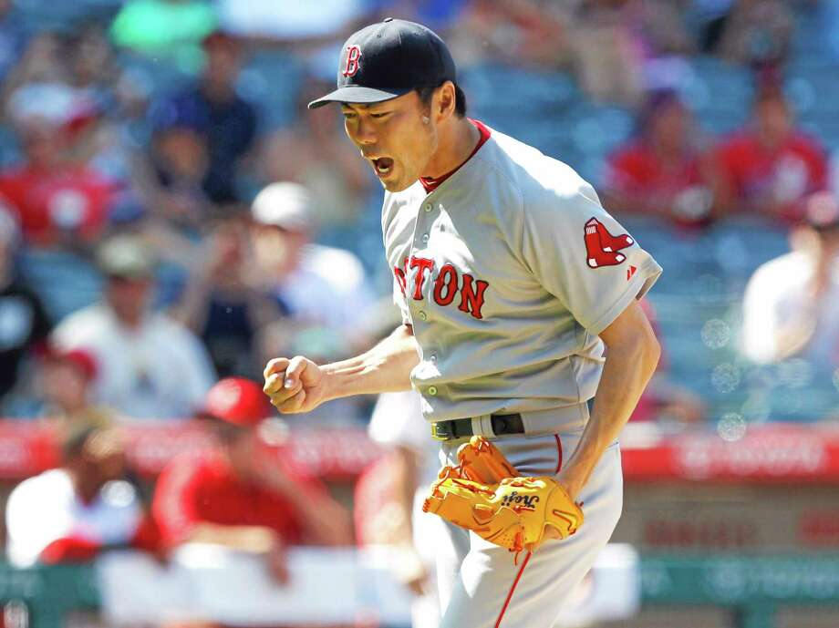 Red Sox closer Koji Uehara reacts after striking out Josh Hamilton to end Sunday's game. Photo: Alex Gallardo — The Associated Press  / FR170211 AP