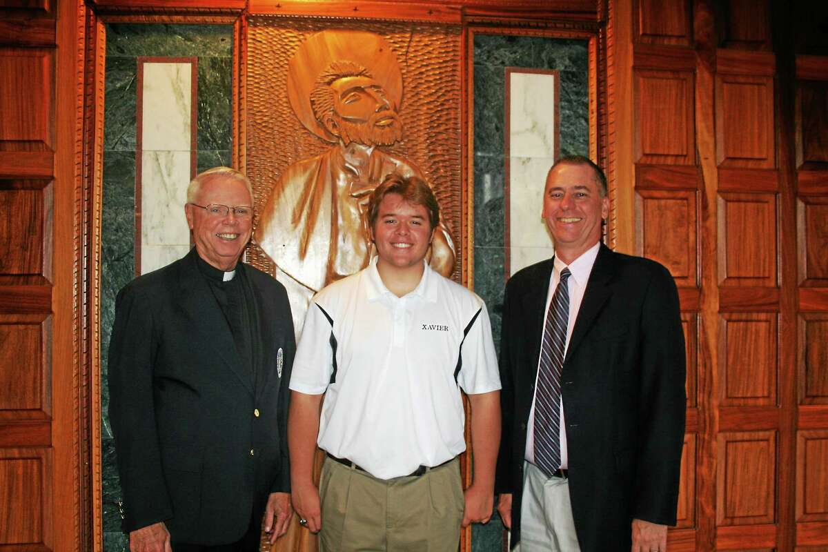 From left are: Brother Brian Davis, headmaster, Nicholas Indorf '15, and Brendan Donohue, principal of Xavier High School in Middletown.