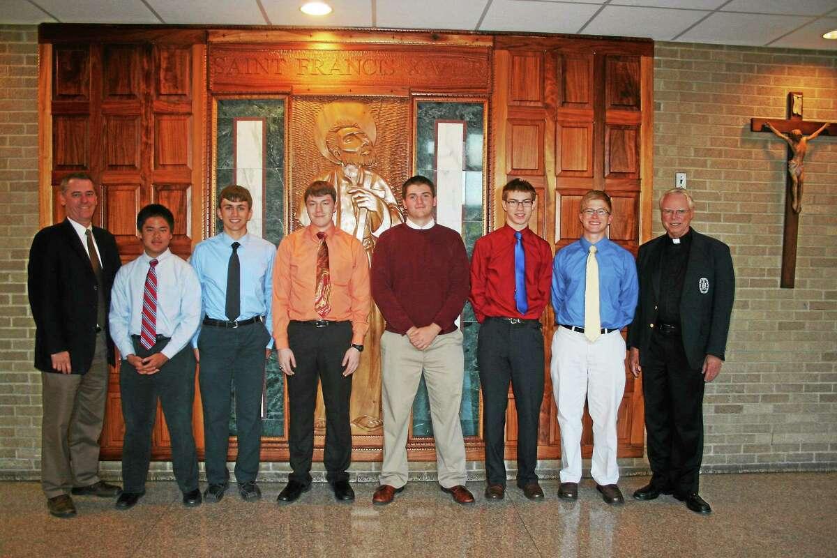 From left are: Xavier High School principal Brendan Donohue, Christopher Lobianco '15, Stephen Bruno '15, Peter McEachern '15, Zachary Radel '15, Anthony Magdzik '15, Mark Capel '15, and Brother Brian Davis, headmaster.