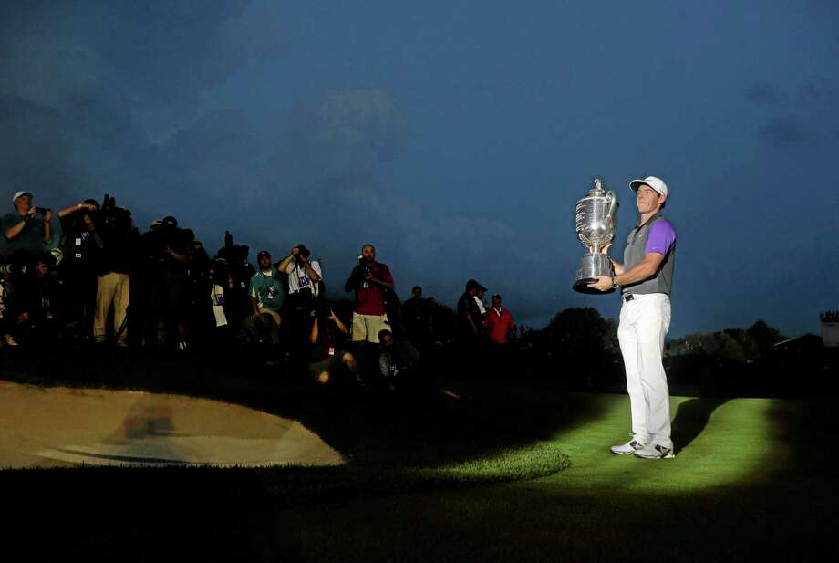 Rory McIlroy holds up the Wanamaker Trophy after winning the PGA Championship Sunday. Photo: Jeff Roberson — The Associated Press  / AP
