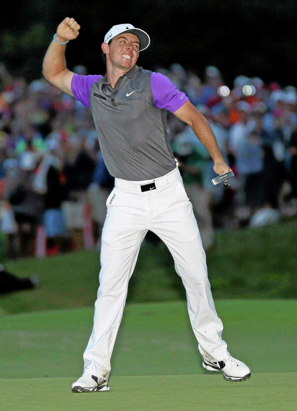 Rory McIlroy celebrates after winning the PGA Championship at Valhalla Golf Club on Sunday in Louisville, Ky.