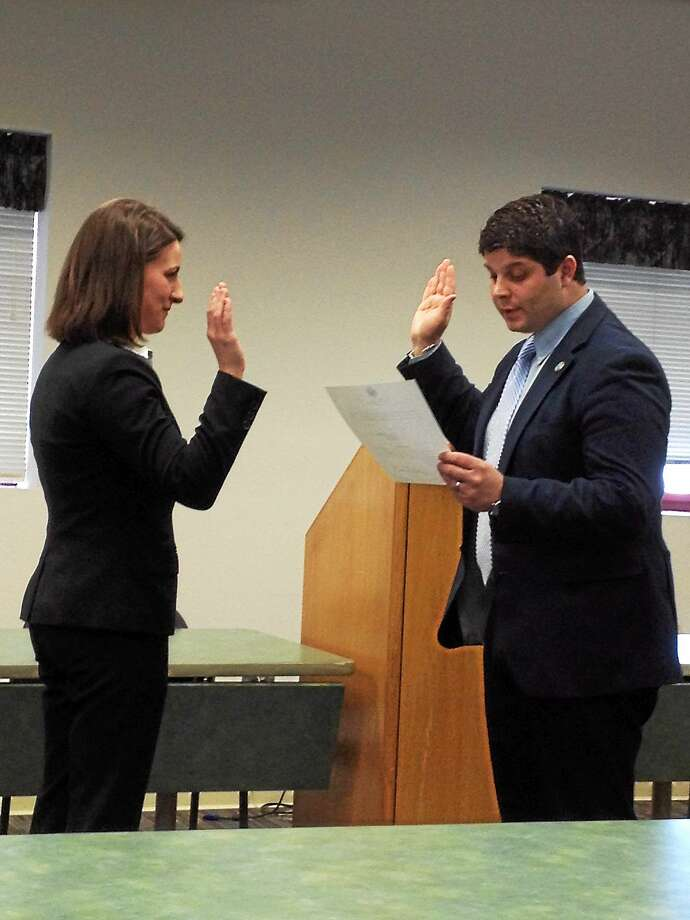 Officer Haley Russenberger is sworn in to the Middletown Police Department by Mayor Dan Drew at a ceremony on April 1. Photo: Brian Zahn — The Middletown Press