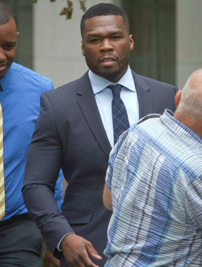 In this July 21, 2015 photo, rapper Curtis Jackson, also known as 50 Cent, leaves court after testifying in front of the jury about his finances, his business deals and the media attention surrounding his recent bankruptcy filing, in New York. Photo: AP Photo/Bebeto Matthews, File  / AP