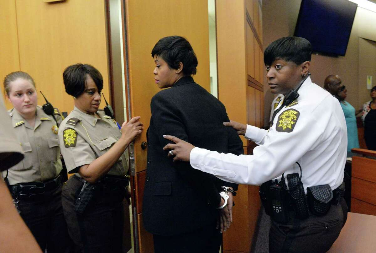 Former Deerwood Academy assistant principal Tabeeka Jordan, center, is led to a holding cell after a jury found her guilty in the Atlanta Public Schools test-cheating trial, Wednesday, April 1, 2015, in Atlanta. Jordan and 10 other former Atlanta Public Schools educators accused of participating in a test cheating conspiracy that drew nationwide attention were convicted Wednesday of racketeering charges.