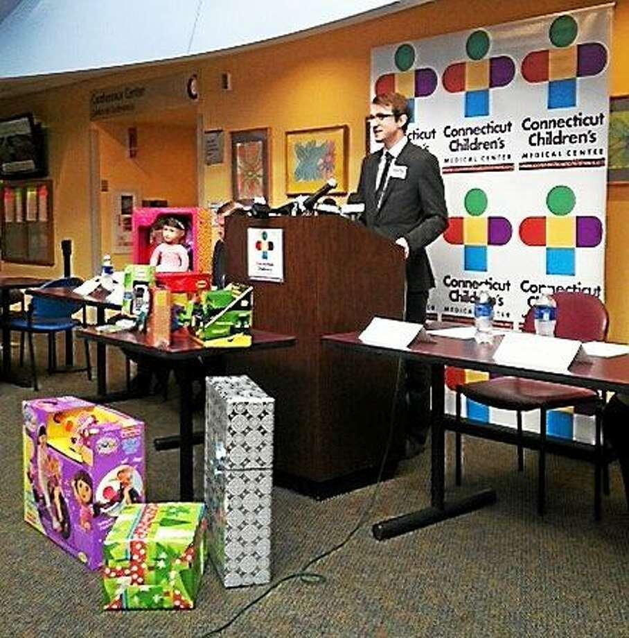 Sean Doyle, campaign organizer with ConnPIRG, discusses the annual Trouble in Toyland report Monday. Photo: MICHELLE TUCCITTO SULLO — NEW HAVEN REGISTER