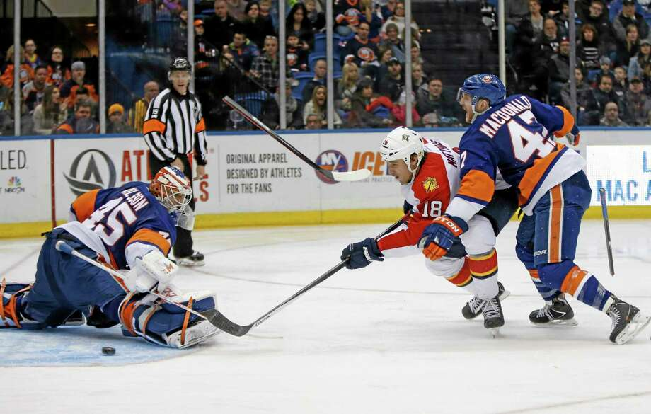 The New York Islanders traded defenseman Andrew MacDonald, right, to the Philadelphia Flyers for draft picks and a minor leaguer. Photo: Kathy Willens — The Associated Press  / AP