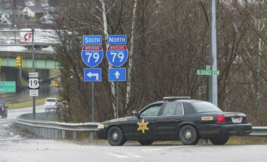 A Sheriffs department patrol car is parked on the exit ramp of exit 155 of I-79 in Morgantown, W.V., Monday, Dec. 1, 2014, after three separate shootings left four people dead on Monday. Photo: (AP Photo/Ben Queen) / ap FR17865