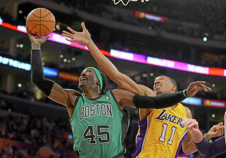 Boston Celtics forward Gerald Wallace is out for the season after multiple surgeries on Tuesday. Photo: Mark J. Terrill — The Associated Press  / AP