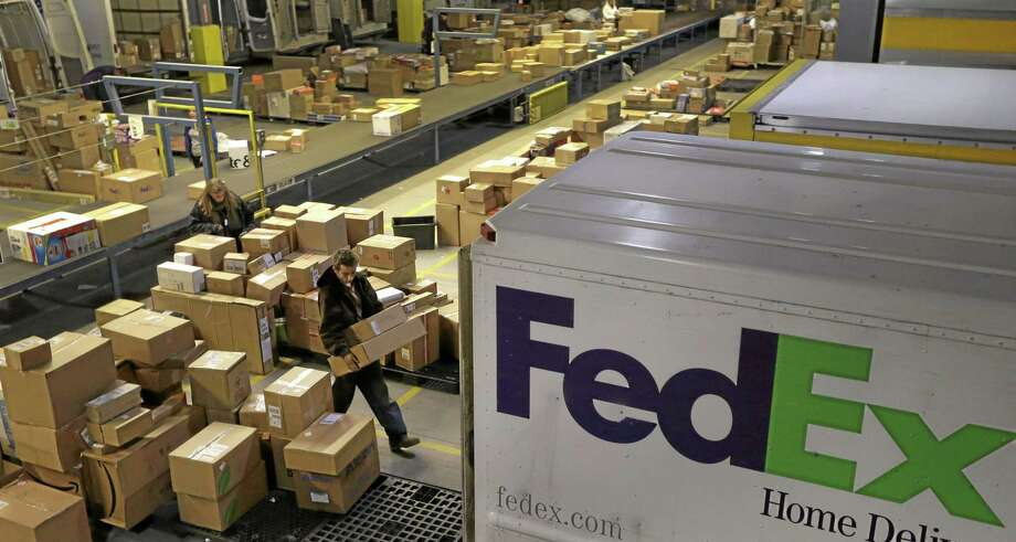 Workers sort packages at a FedEx sorting facility. Middletown Mayor Dan Drew and planning officials are hoping the company will build a similar hub in town at the old Aetna site. Photo: File  / AP