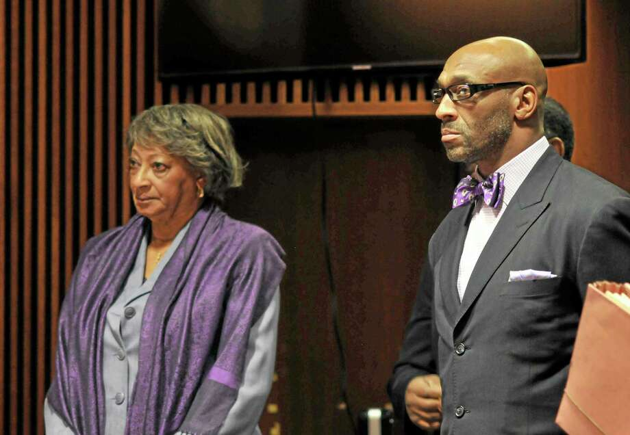 Former NFL football star, Irving Fryar, right, and his mother Allene McGhee appear before Judge James W. Palmer in Burlington County Superior Court in Mount Holly, N.J.  Fryar faces a five-year sentence under a plea deal, and his mother, Allene McGhee, has been offered a three-year prison sentence, according to the state attorney general's office, which is prosecuting the case. Photo: The Associated Press File Photo  / Pool Burlington County Times