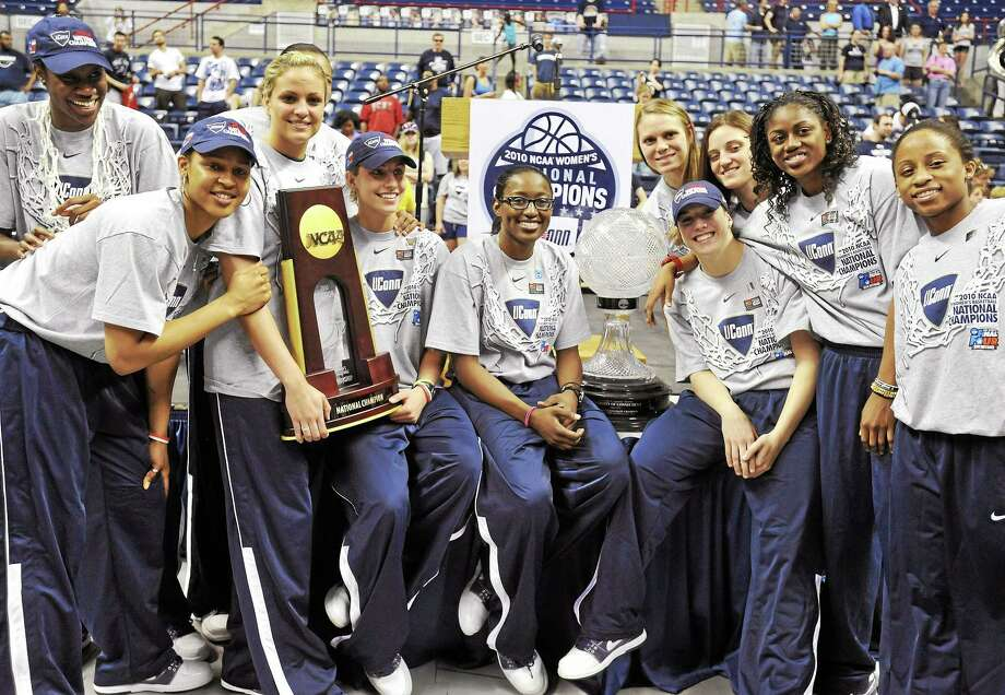 Associated Press The UConn women defeated Stanford 53-47 in the 2010 NCAA women's basketball tournament to finish the season 39-0. Here they celebrate at a rally upon their arrival back in the state. Photo: AP / AP2010