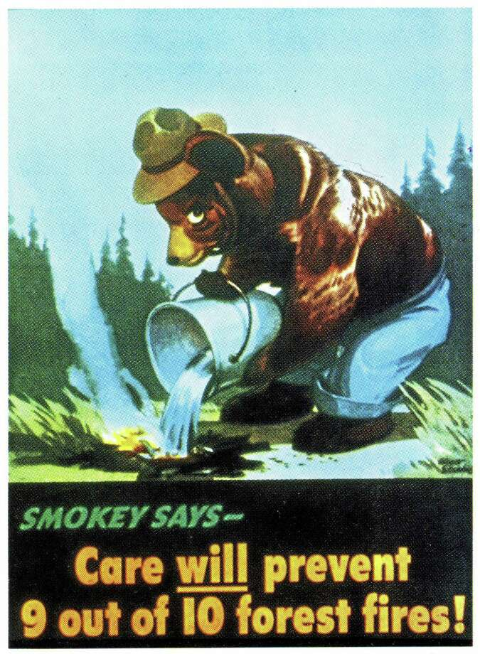 This image provided by the Ad Council  circa 1945 shows an early version of the Smokey Bear campaign.  Smokey Bear was created in 1944 because of fears that enemy shelling from Japan would cause forest fires while most U.S. firefighters were in battle overseas. When the war ended, Smokey stuck around _ and he is now at the center of the longest-running public service announcement campaign in U.S. history. Research shows he is known by 96 percent of American adults and ranks near Mickey Mouse and Santa Claus for name recognition. Smokey turns          seventy on Saturday Aug. 9, 2014. (AP Photo/Ad Council) Photo: AP / Ad Council