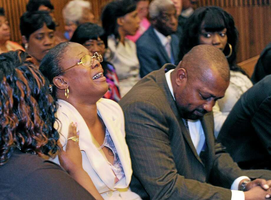 Monica McBride, mother of Renisha McBride cries during the reading of verdict of guilty of of second-degree murder and manslaughter for Theodore Wafer, Thursday, Aug. 7, 2014 in Detroit. Walter Ray Simmons, Renisha's father, is at right. Wafer, 55, shot Renisha McBride through a screen door on Nov. 2, hours after she crashed into a parked car a half-mile from his house. The jury convicted Wafer of second-degree murder and manslaughter after deliberating for about eight hours over two days.  (AP Photo/The Detroit News, Clarence Tabb Jr.) Photo: AP / The Detroit News