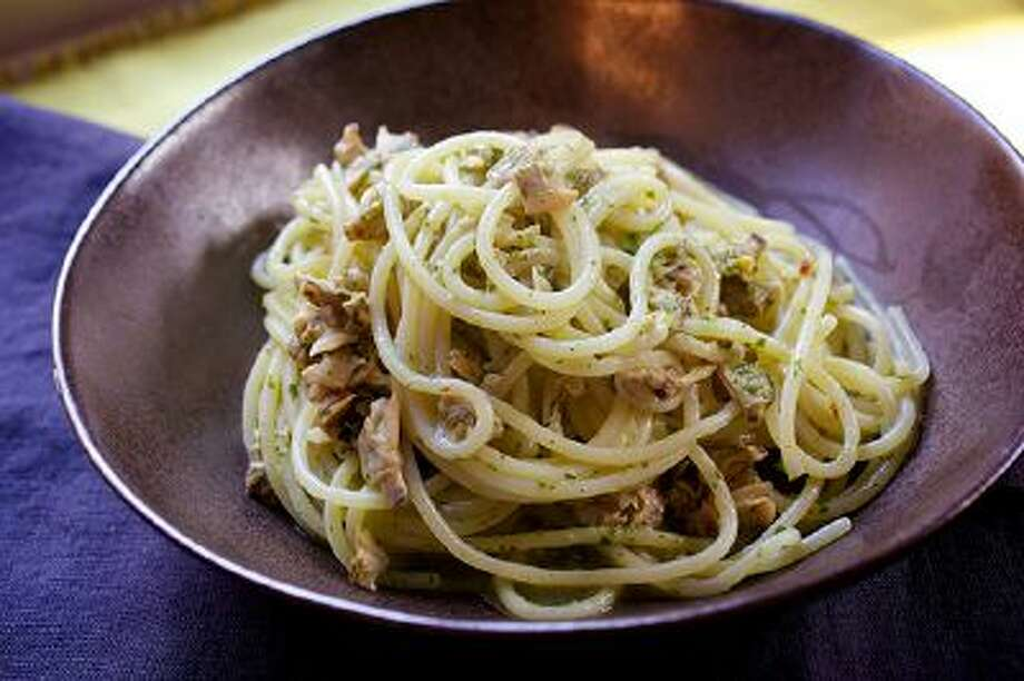 Spaghetti With Baby Clams and Arugula Pesto. Illustrates FOOD-MARKET (category d), by David Hagedorn, special to The Washington Post. Moved Monday, March 3, 2014. (MUST CREDIT: Photo for The Washington Post by Deb Lindsey) Photo: The Washington Post / THE WASHINGTON POST