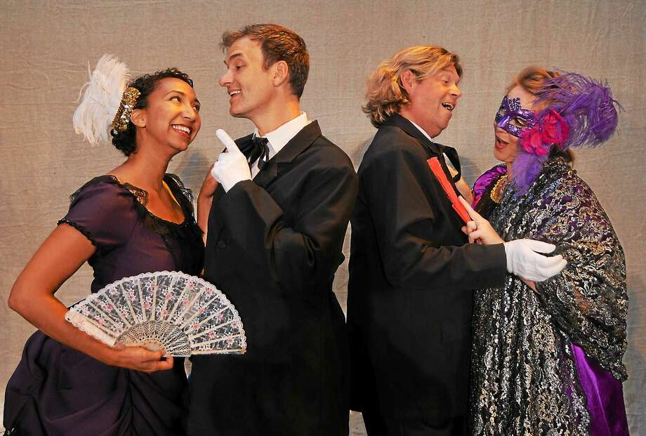"Photos by Alan Casavant Lisa Williamson (Adele), Mark Womack (Falke), Marc Deaton (Eisenstein), and Amanda Hall (Rosalinda) in Opera Theater of Connecticut's upcoming production of ""Die Fledermaus"" in Clinton. Photo: Journal Register Co."