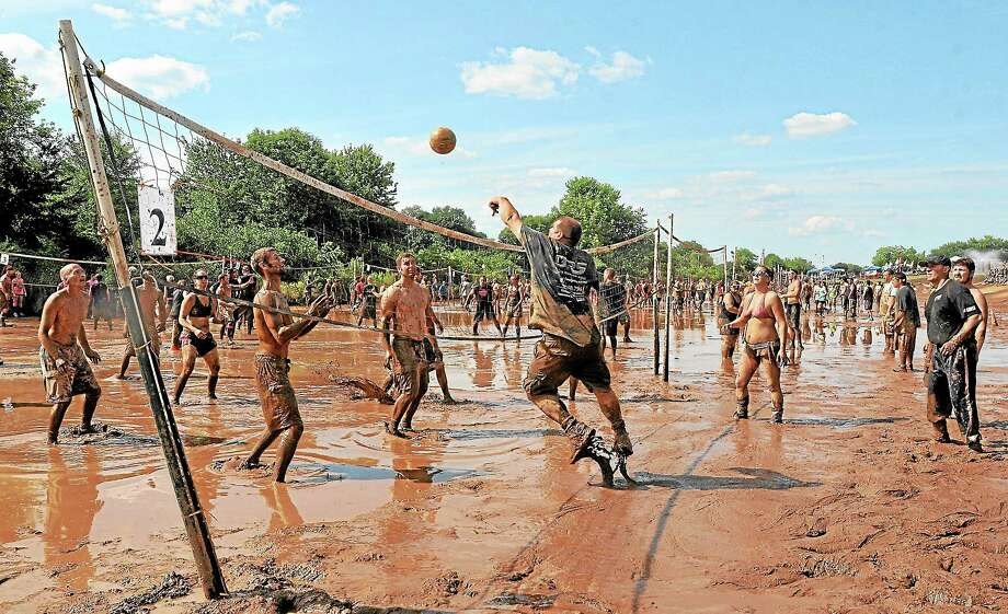 Two hundred and sixteen teams with names like Muddy Mayhem and Captain Mud infiltrated 24 courts at Zoar's Pond at the 2013 tournament in Middletown Saturday afternoon. More than $65,000 was raised for the Epilepsy Foundation. Photo: Catherine Avalone — The Middletown Press  / TheMiddletownPress