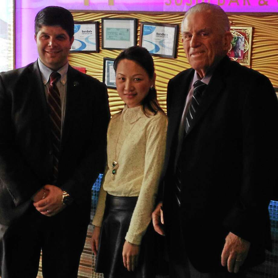 Michael T. Lyle Jr. - The Middletown Press Moonlight Sushi Bar & Grill, a new sushi and hibachi restaurant opened its doors for business two weeks ago in the Metro Square complex in Middletown. Lin Ling, owner and manager of the new facility on 130 Main Street, was greeted by Middletown Mayor Dan Drew (left) and Middlesex County Chamber of Commerce President Larry McHugh during a grand opening celebration Tuesday. Photo: Michael T. Lyle Jr. — The Middletown Press
