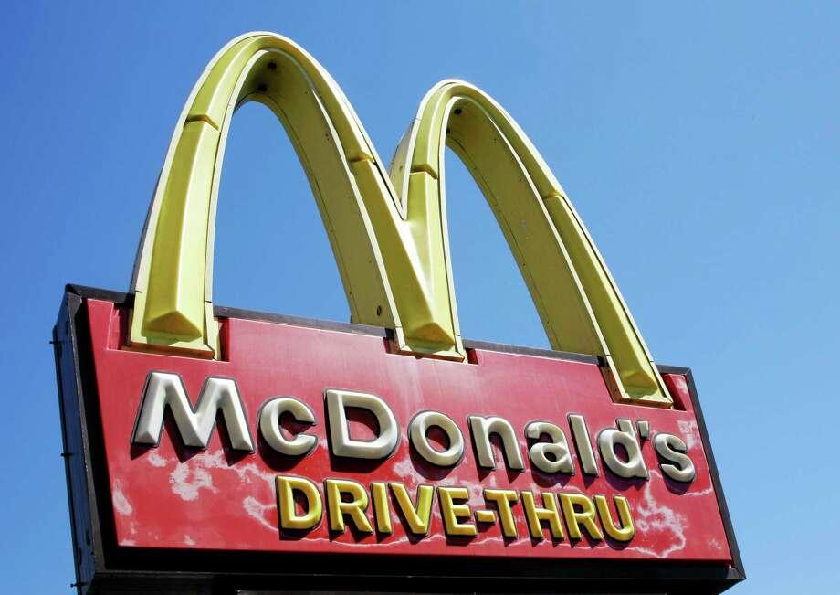 A McDonald's sign is displayed at a McDonald's restaurant in East Palo Alto, California. Photo: Paul Sakuma — The Associated Press  / AP