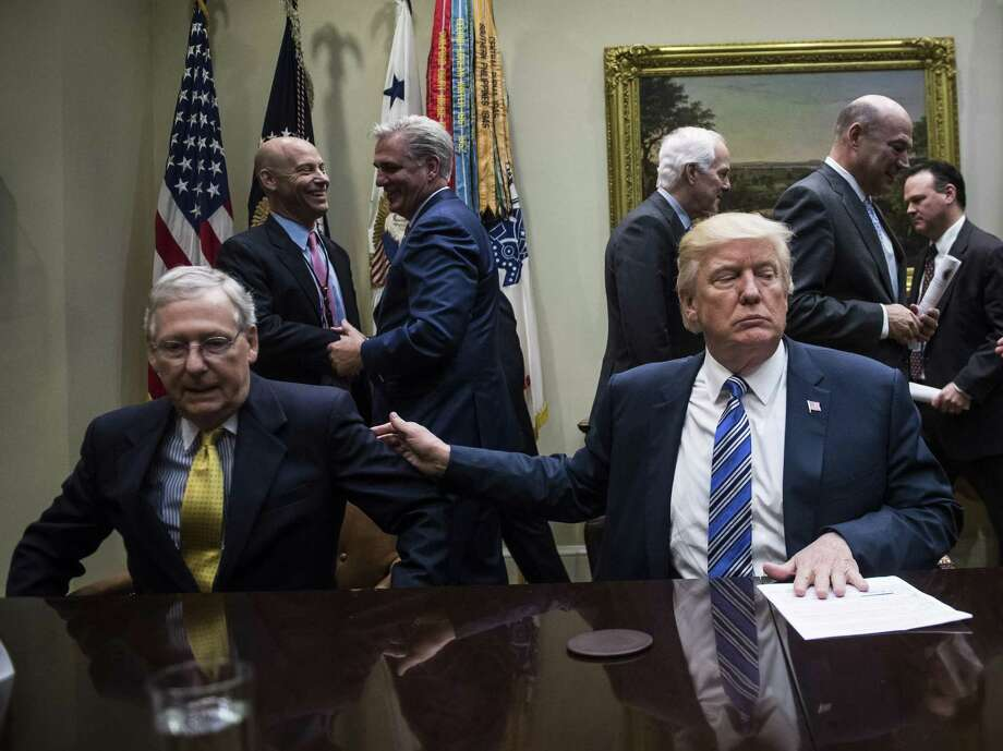 Senate Majority Leader Mitch McConnell (left) joins President Trump at a meeting of congressional leaders at the White House in June. Photo: The Washington Post / The Washington Post/Getty Images / 2017 The Washington Post
