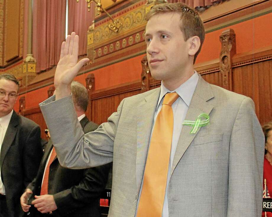 Submitted photo ¬ SWEARING IN: State Rep. Matthew Lesser, D-Middletown, was sworn into office Wednesday during the opening day ceremony at the Connecticut General Assembly in Hartford. Lesser has been tapped as assistant majority leader and will serve on General Assembly's Appropriation's Committee, which has cognizance of all matters relating to appropriations and the budgets of state agencies. Photo: Journal Register Co.