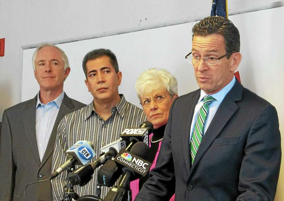CTMirror.org photo ¬ Gov. Dannel Malloy was joined by Lt. Gov. Nancy Wyman, legislators and Mayor Bill Finch, at left, at a recent announcement for his minimum wage proposal in Bridgeport. ¬ Photo: Journal Register Co.