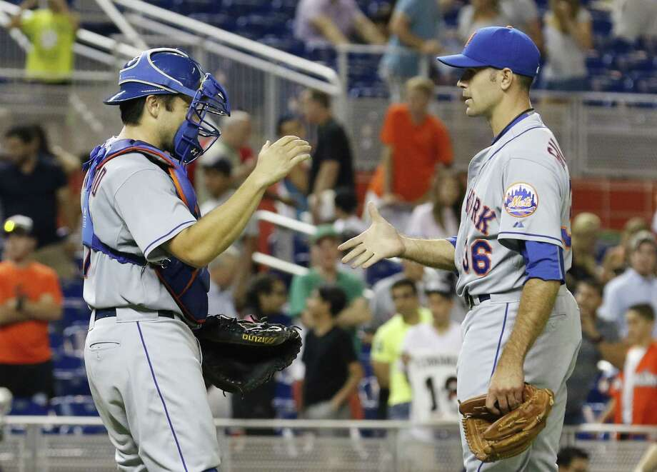 New York Mets relief pitcher Sean Gilmartin, right, celebrates with catcher Travis d'Arnaud as the Mets defeated the Miami Marlins 12-1 during a baseball game in Miami, Monday. Photo: Joe Skipper — The Associated Press  / FR171174 AP
